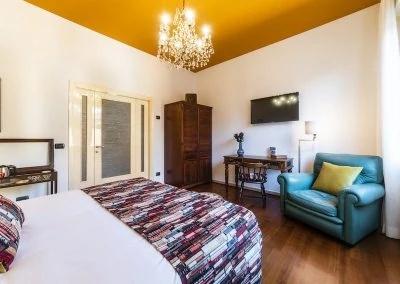Stanza del Viaggiatore per camere a Bologna di Bibliò Rooms